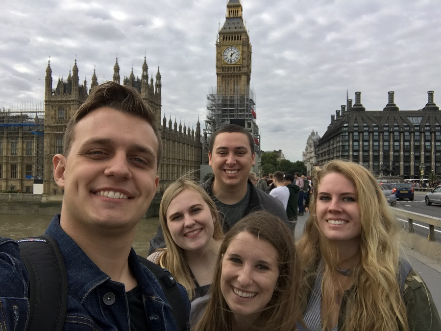 group of students stand in front of big ben